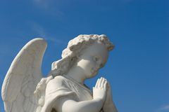 Angel. Statue of a white angel praying Royalty Free Stock Photos