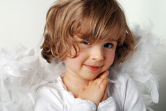 Angel. Little girl with wings on white stock image