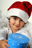Angel. Little girl with wings on white with present Royalty Free Stock Image