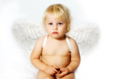 Angel. Small chubby angel on a white background Royalty Free Stock Photography