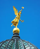Angel. Golden angel un the top of the building Royalty Free Stock Photography
