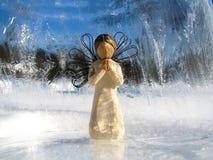 Angel. Praying in Ice globe Stock Images