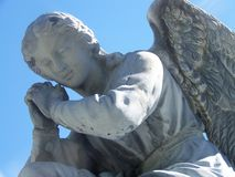 Angel. An old weathered angel gives peace to to anyone looking at her Royalty Free Stock Images