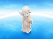 Angel above the world. And space Royalty Free Stock Photos