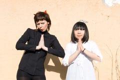 Angel And Devil Together Stock Image
