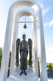 Angel at the Arch. Sculpture of an angel standing in the arch with a bell Stock Photography
