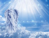 Angel Archangel Ariel with divine rays of light. Angel archangel Ariel, Gabriel with beautiful divine angelic mystical rays of light and stars over cloudy sky Stock Photography