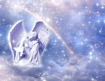Angel Archangel Haniel with rainbow. Angel archangel Haniel over divine mystical angelic background with cloudy sky, stars and rainbow with copy space in purple royalty free stock photography