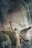 Angel ascending. Textured image of angel ascending to the skies, with colored light effects and gothic background for book cover design Stock Photography