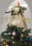 An Angel Atop a Decorated Christmas Tree Royalty Free Stock Photography