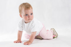Angel baby. Child sits. Soft, over white Royalty Free Stock Image