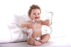 Angel baby girl. Sweet little baby with angel wings laughing Royalty Free Stock Images