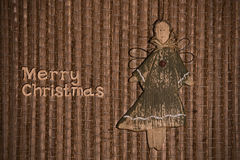 Angel on background of reed mat. Christmas greeting with angel on background of reed mat Stock Photo