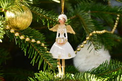 Angel and balls. White angel and balls on the Christmas tree royalty free stock images