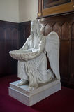 Angel with the baptismal font Stock Photos