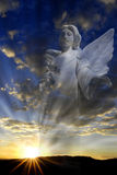Angel and Beams of Light. Hope and love through an Angel and rays of light Royalty Free Stock Images