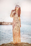 Angel. Beautiful girl in a brilliant dress at the seaside Royalty Free Stock Photography