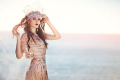 Angel. Beautiful girl in a brilliant dress at the seaside Stock Images