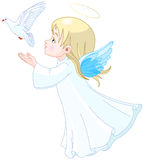 Angel. Beautiful angel releases doves in the sky Royalty Free Stock Image