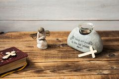 Angel bible and cross. A angel bible and cross on wooden background royalty free stock photo