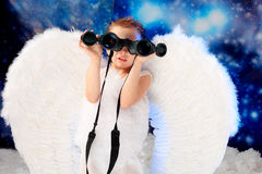 Angel with binocular Stock Image