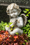 Angel with bird in his hands Stock Images