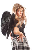 Angel with black wings. Turns her head Royalty Free Stock Image