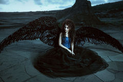 Angel with black wings royalty free stock photos