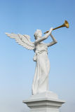 Angel blowing a trumpet Royalty Free Stock Photos