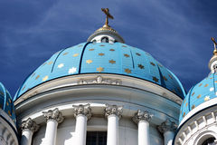 Angel on the blue dome with gold stars Stock Images