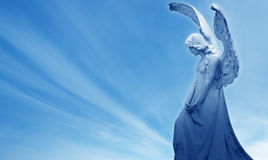 Angel on blue sky background concept of Religion Royalty Free Stock Photography
