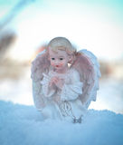 Angel on blue sky background. Religion and faith concept. Royalty Free Stock Photography