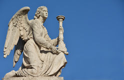 Angel with blue sky and copy space. An angel look at the heaven Stock Photos