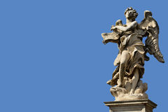 Angel with blue sky and copy space. The magnificent bridge of Sant'Angelo with Bernini's marble angels Stock Photography