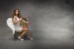 Angel with bow and arrow Stock Photography