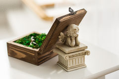Angel. Box, engagement rings, statues, wedding decor, wedding rings, wooden box Stock Photography