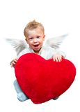 Angel boy. Laughing cute angel boy with big plush red heart. Isolated on white background Stock Images