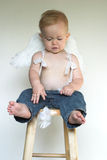 Angel Boy. Image of an adorable toddler wearing angel wings and jeans Stock Photo