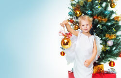 Angel Boy And Christmas Tree Stockfoto