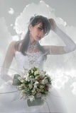 Angel bride. Portrait of the bride looks like angel against clouds stock photography