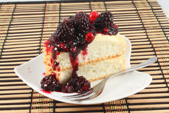 Angel Cake with berry sauce Stock Photos