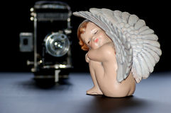 Angel with camera Stock Images