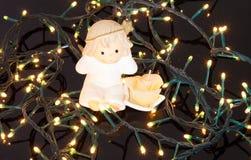 Angel candle on christmas lights Stock Photo