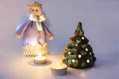 Angel, candles and Christmas tree royalty free stock photo