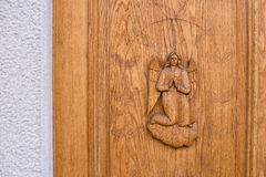 Angel carved on a wooden door Royalty Free Stock Photo