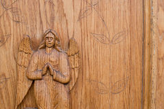 Angel carved on a wooden door Royalty Free Stock Photos