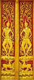 Angel carvings door Thai church. Stock Photos