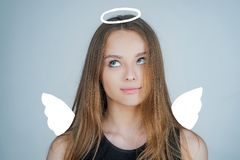 Angel. Child with angelic character. Lovely and cute youth. Girl angel with halo in white angel dress. Valentines day. Cupid stock photo