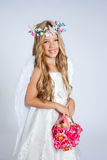 Angel children girl holding flowers bag with wings Royalty Free Stock Image