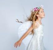 Angel children girl wind in hair. Angel children girl with wind in hair fashion white wings and flowers crown Stock Image